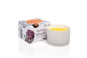 Orange scented travel candle in white frosted glass and floral packaging.
