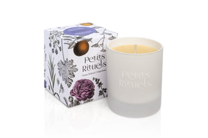 Aromatherapy stress relief candle in luxury white frosted glass and floral packaging.