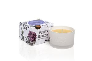 Ylang Ylang candle in travel size and white frosted glass and floral packaging.