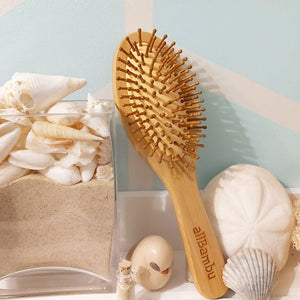 Made from organically grown bamboo, our eco-friendly hairbrush is suitable for all hair types and is the ultimate hair accessory for your hair. Stylish contoured smooth bamboo handle is biodegradable and antibacterial. The pins are bamboo as well which help naturally condition your hair, and evenly distribute your hairs' natural oils.
