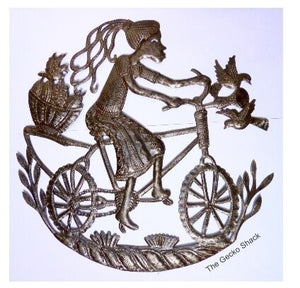 Caribbean Girl riding her bike 60cm recycled metal art