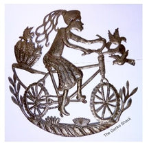Load image into Gallery viewer, Caribbean Girl riding her bike 60cm recycled metal art