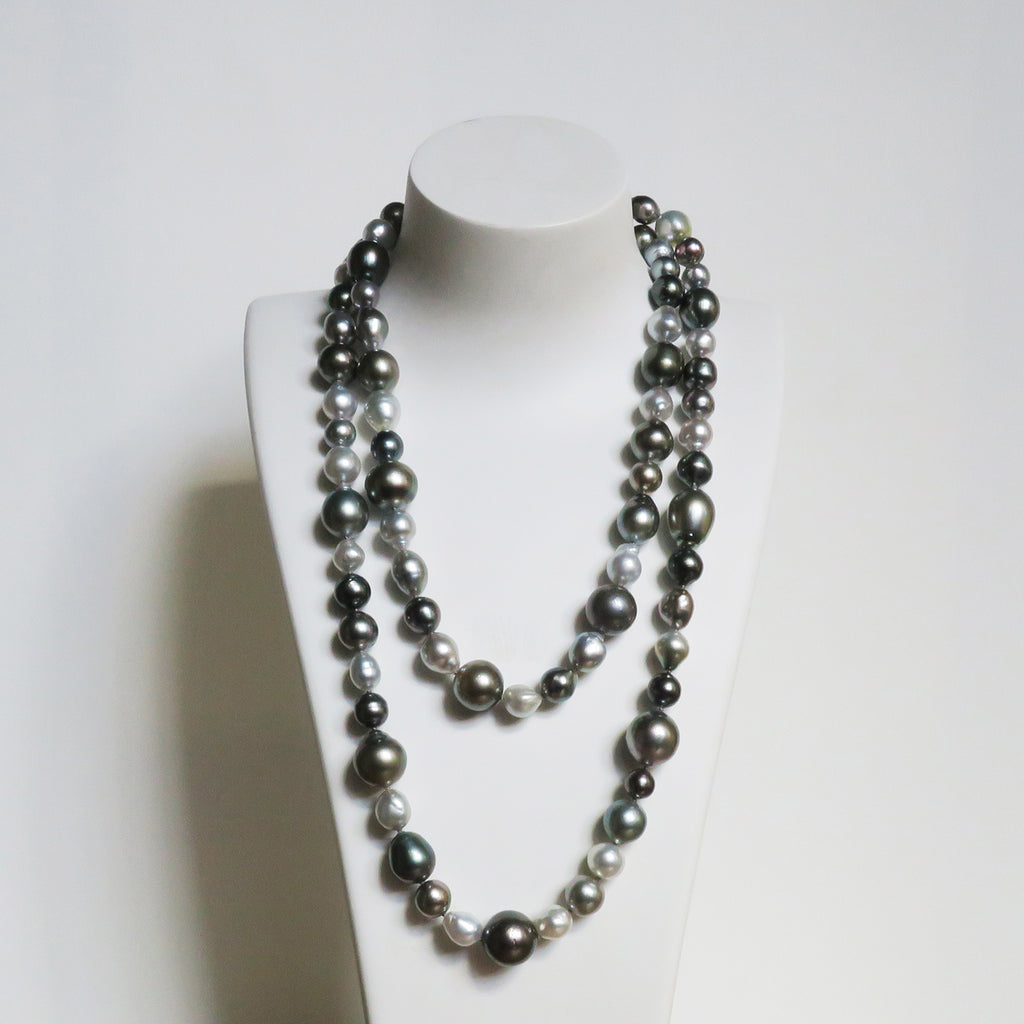 pearl strand silver grey black Tahitian south sea pearls. White background.