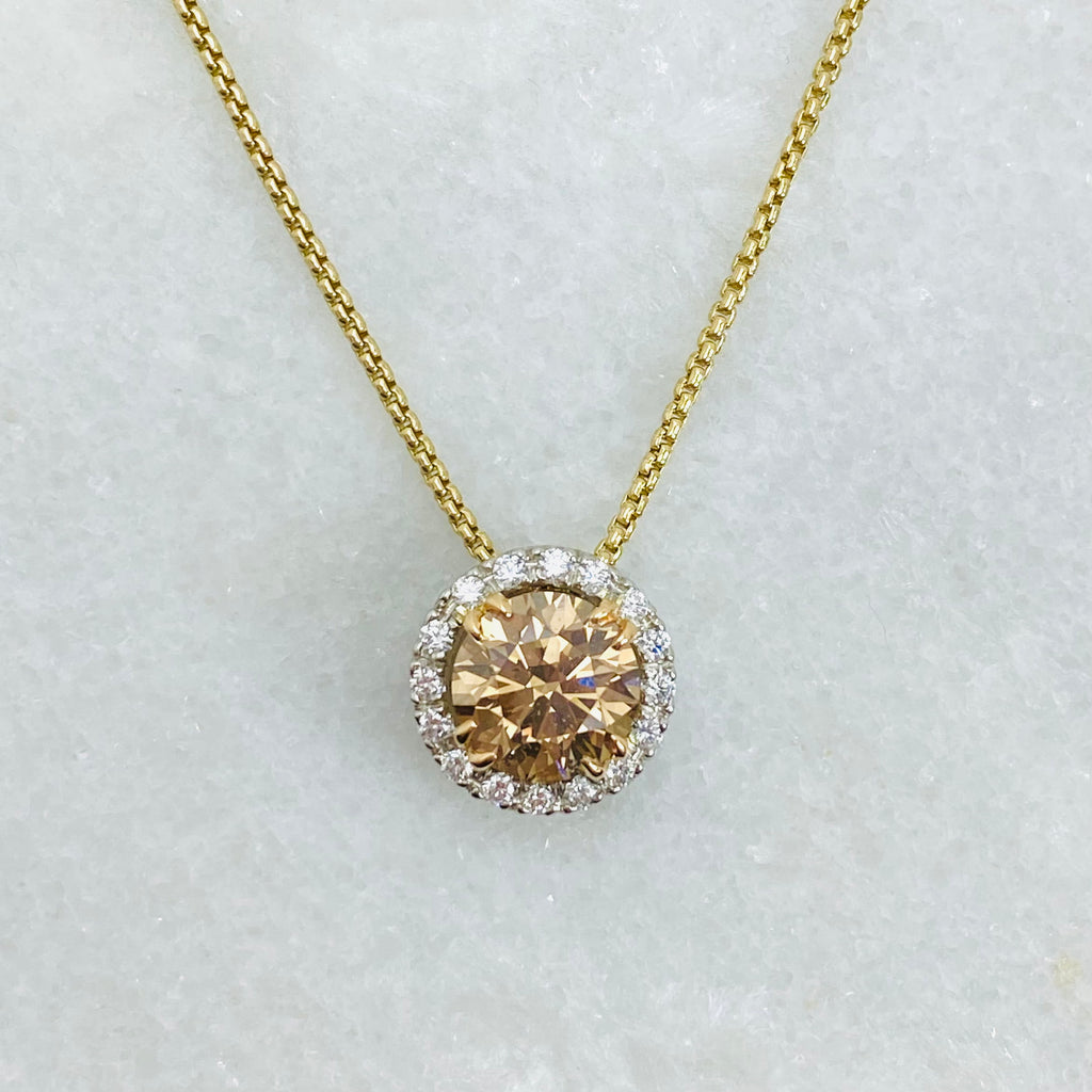 cognac diamond halo pendant white background 18ct rose gold
