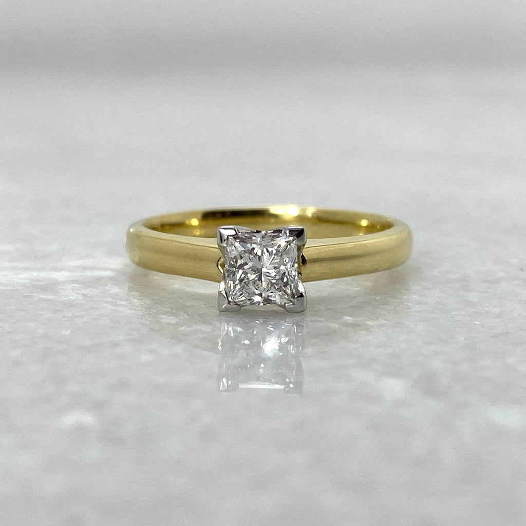 Sargisons yellow gold Tasmanian made princess cut diamond ring. Off white background.