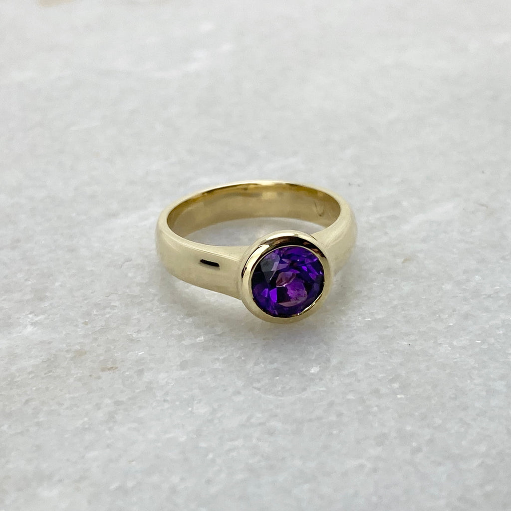 Sargisons yellow gold bezel set amethyst gemstone Tasmanian made ring white background