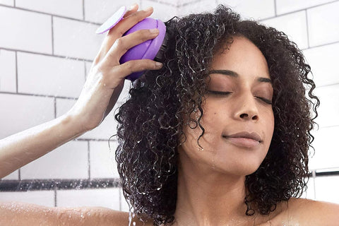 showering with a scalp brush