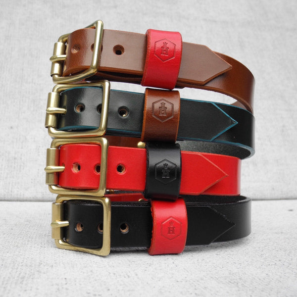 Stack of Brown, Geen, Red, Black luxury leather dog collars on white background