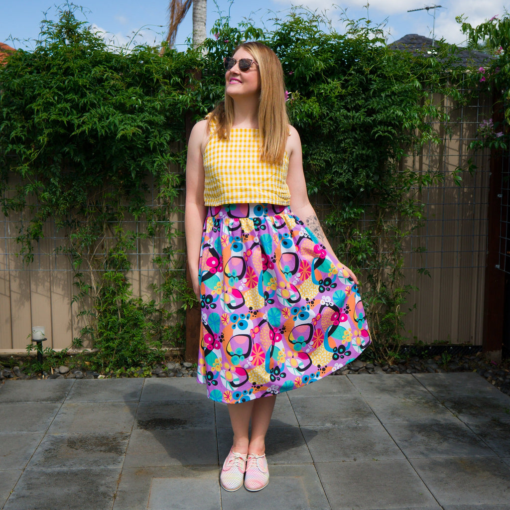 Ladies Mustard gingham crop top with atomic jumble midi skirt