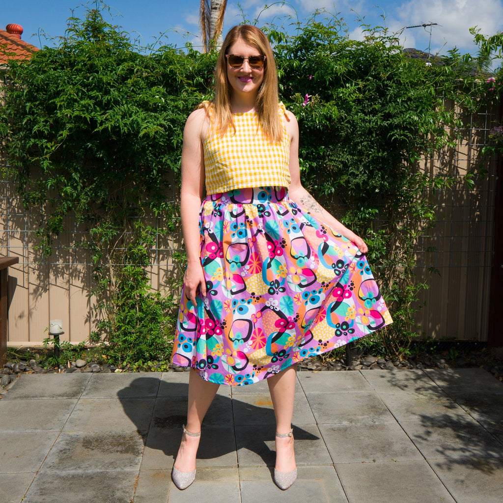 Ladies midi skirt and crop top in atomic jumble print with purple, pink and mustard