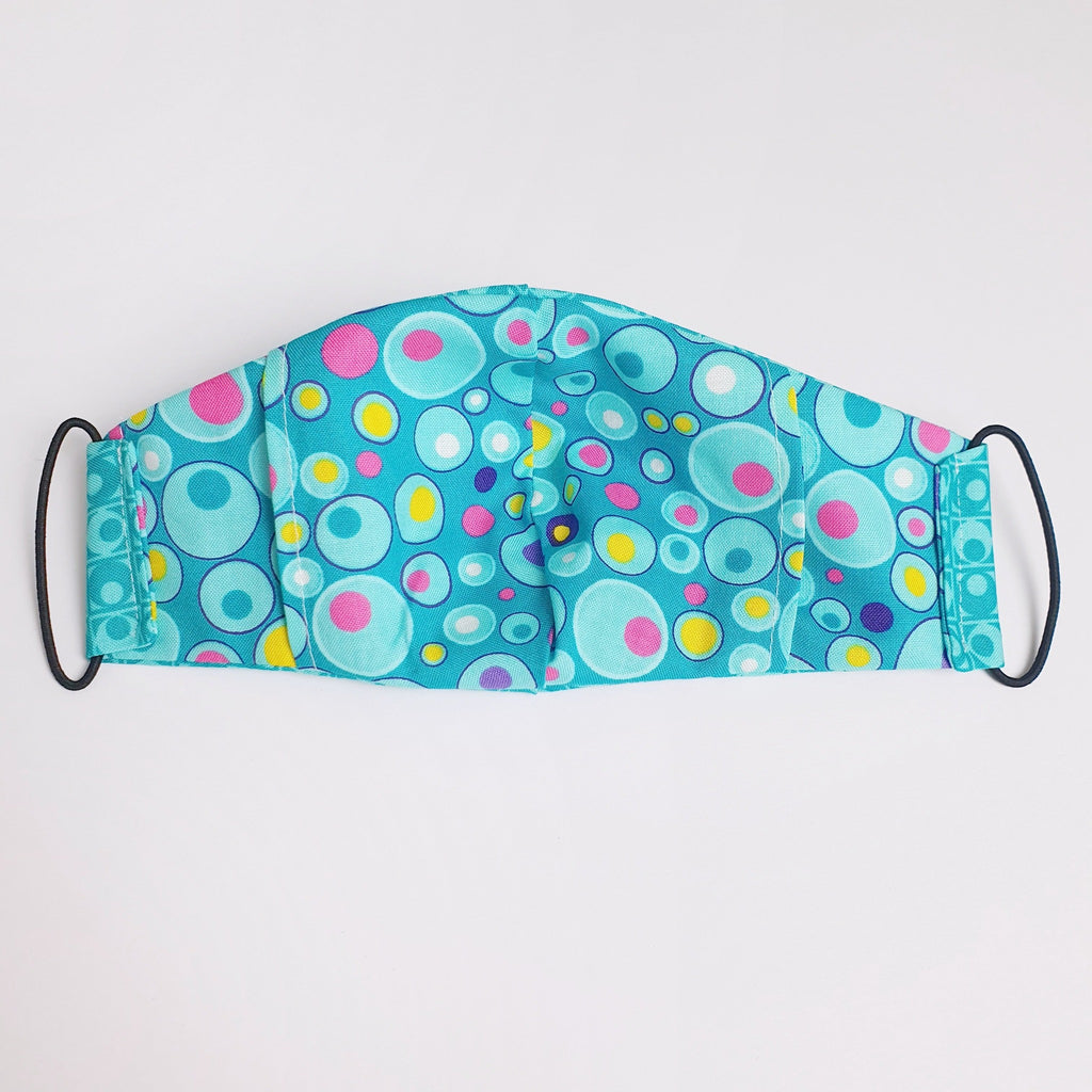 Face mask made from 2 layers of cotton fabric with internal pocket for filter.  Adult and children's sizes.