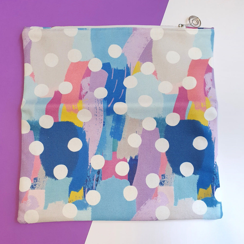 Canvas fold over clutch bag in blue polka dot.  Perfect for use as a cosmetic bag, makeup pouch, toiletries bag or going out bag.