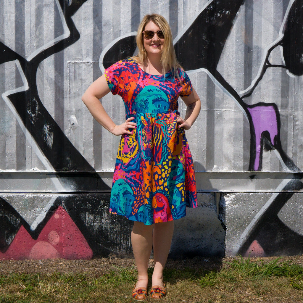 Ladies summer dress with cap sleeves in animal print.  Jungle boogie fabric was designed in Australia with gorilla, cheetah, leopard print, snakes, parrots and giraffes.  Designed and made in Australia from cotton fabric.