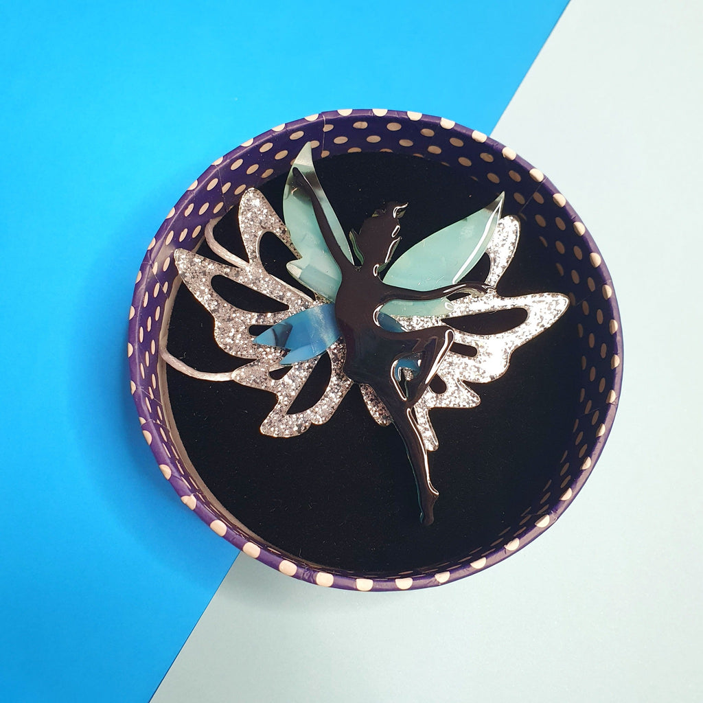 The Fae Wild Brooch by Erstwilder, Fairy with blue and silver glitter resin wings