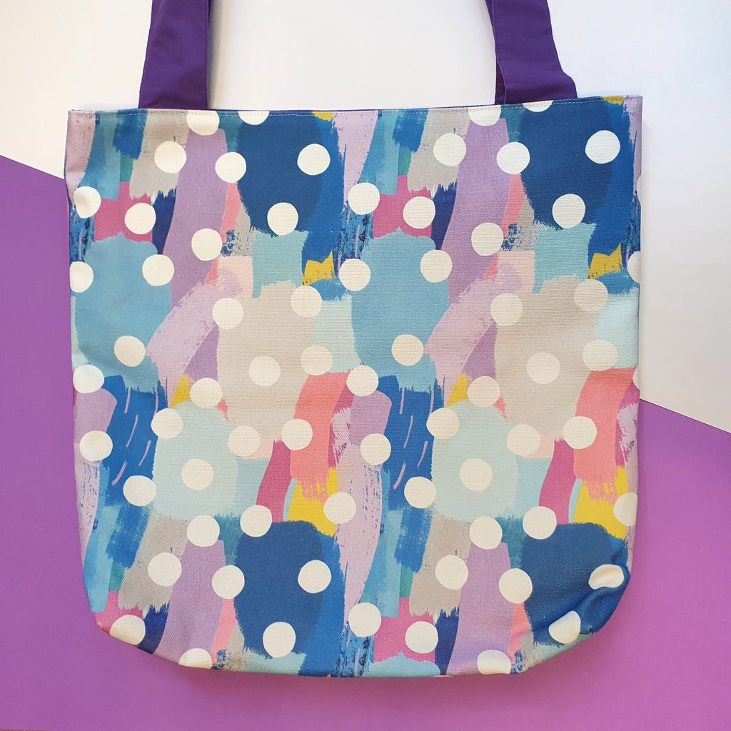 Canvas tote bag in blue, purple and pink with polka dots.  Ideal for use an overnight bag, reusable produce bag or book bag.