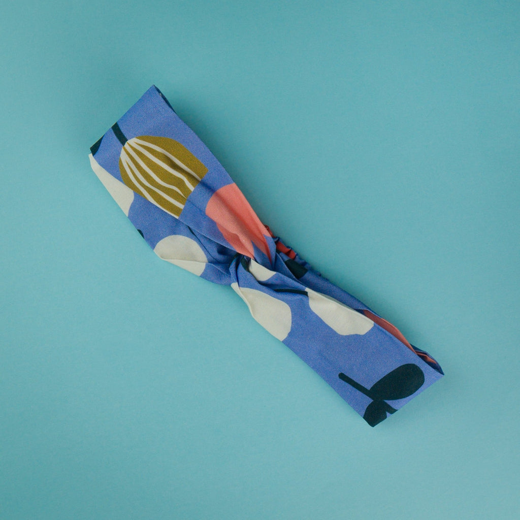 Headbands handmade in Australia.  Blue background with mustard, peach and white. Twist headband with elastic back.  Free postage