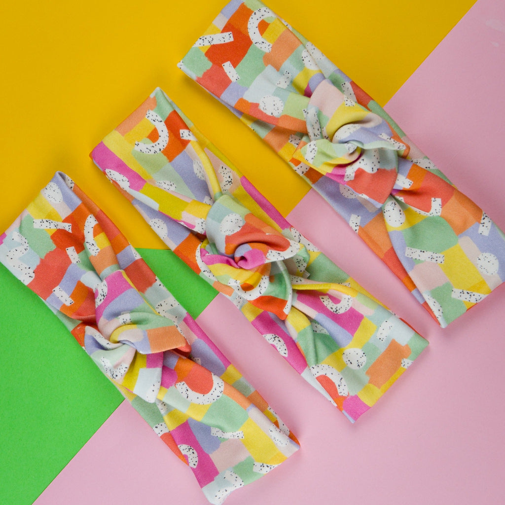 Ladies headbands australia in pastel rainbow print.  Topknot girl made in Australia