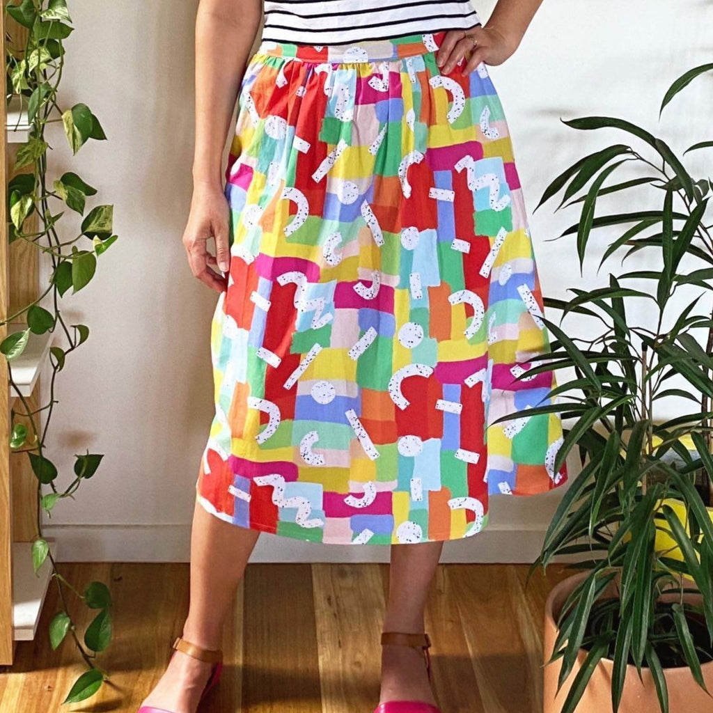 Midi length skirt with zipped waistband in pink, purple, blue and yellow.