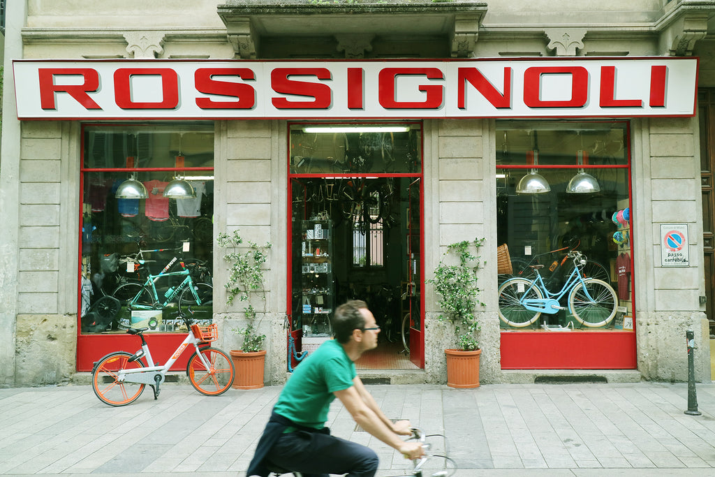 Storefront and signage of Rossignoli, a bicycle shop in Milan, Italy