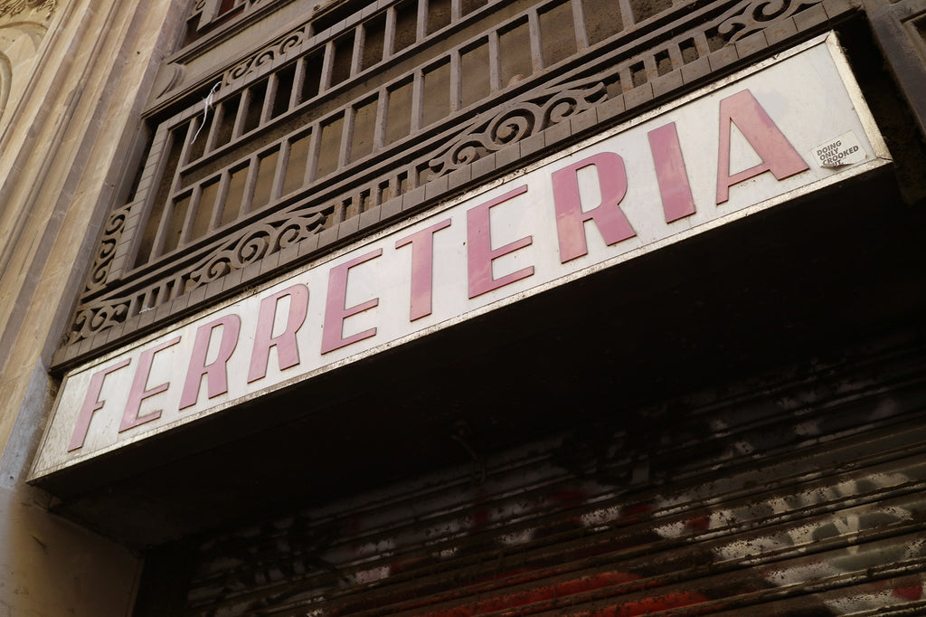 Storefront sign of Ferreteria, a hardware store, in Barcelona, Spain