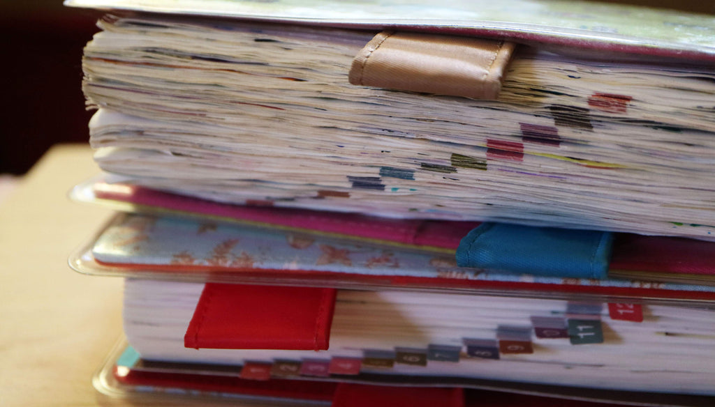 Image: two of Sophie's Hobonichi Journals stuffed thick