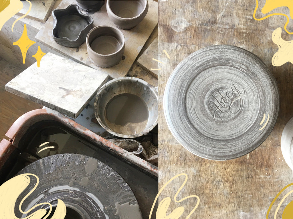 Unfinished bowls around Abbey Sy's pottery wheel at Tahanan Pottery Studio