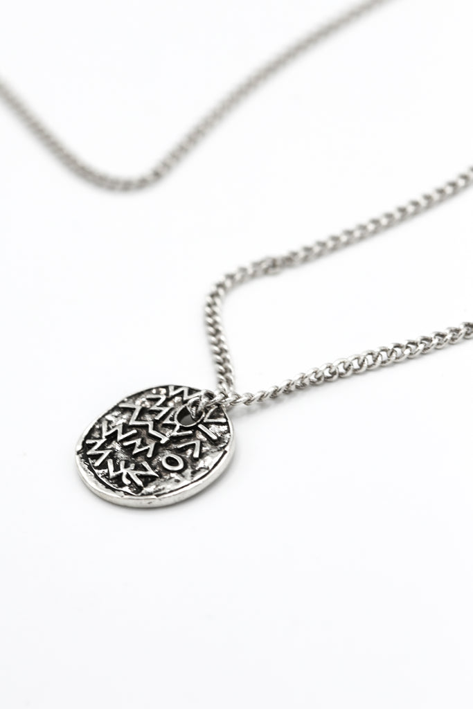 Embossed Symbol necklace