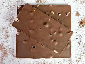 100g milk chocolate bar embedded with toasted hazelnuts
