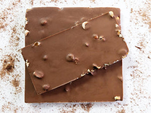 100g milk chocolate bar embedded with peanuts and raisins.