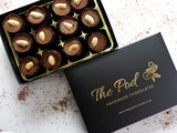 Peanut butter and caramel cups in a luxurious gift box.