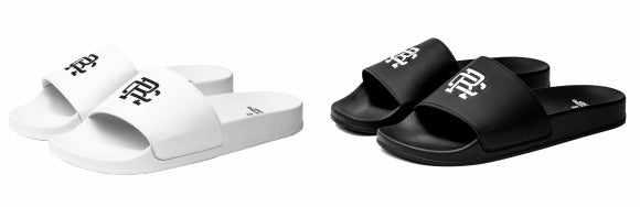 White and Black Reigning Champ slides - side view