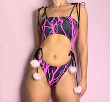 Load image into Gallery viewer, UV reactive neon pink lightning rave bodysuit bikini with fluffy faux fur pom poms
