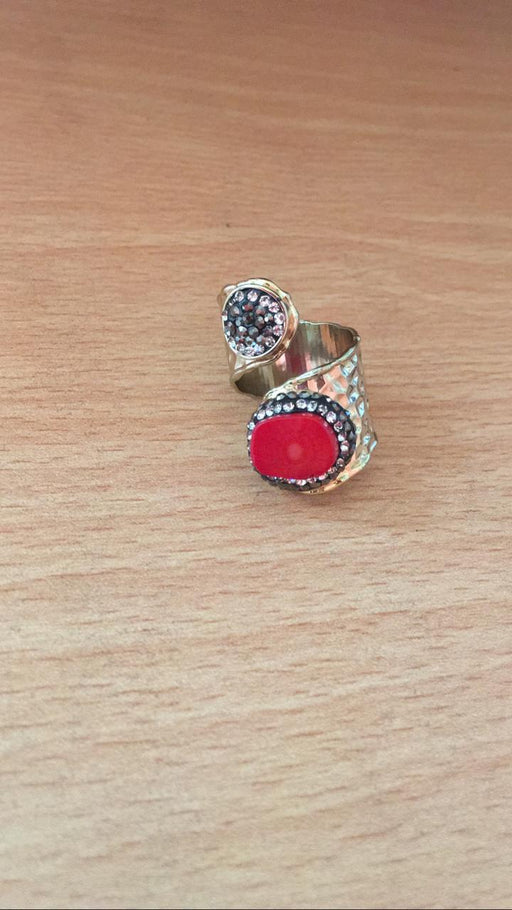 Ring with big red rock