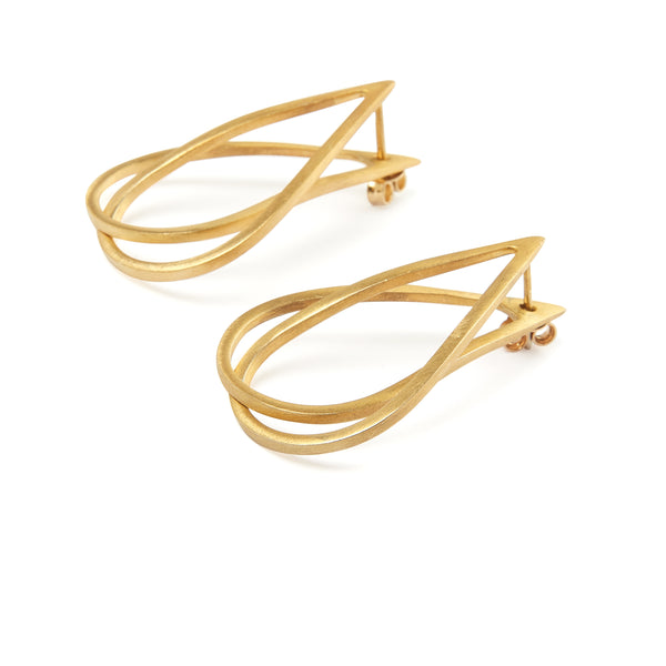 Changeable ear jacket earrings, comprised of two drop shaped elements, made of platinum-plated or gold-plated silver 925. 2 interlocking drops, can be worn short like ear jackets or long.