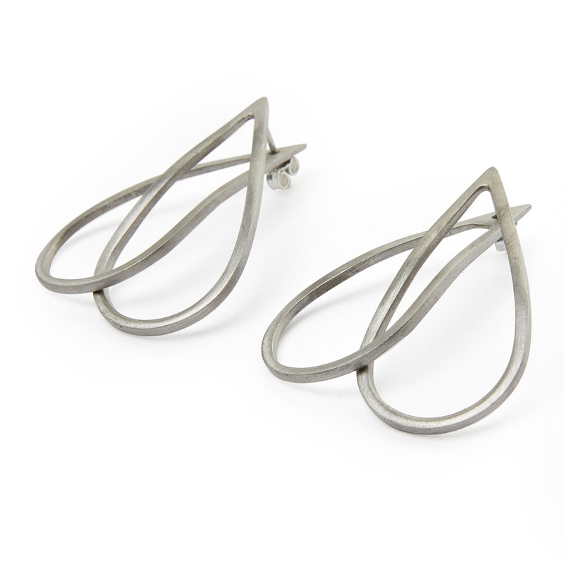 Interlocking ear jacket earrings