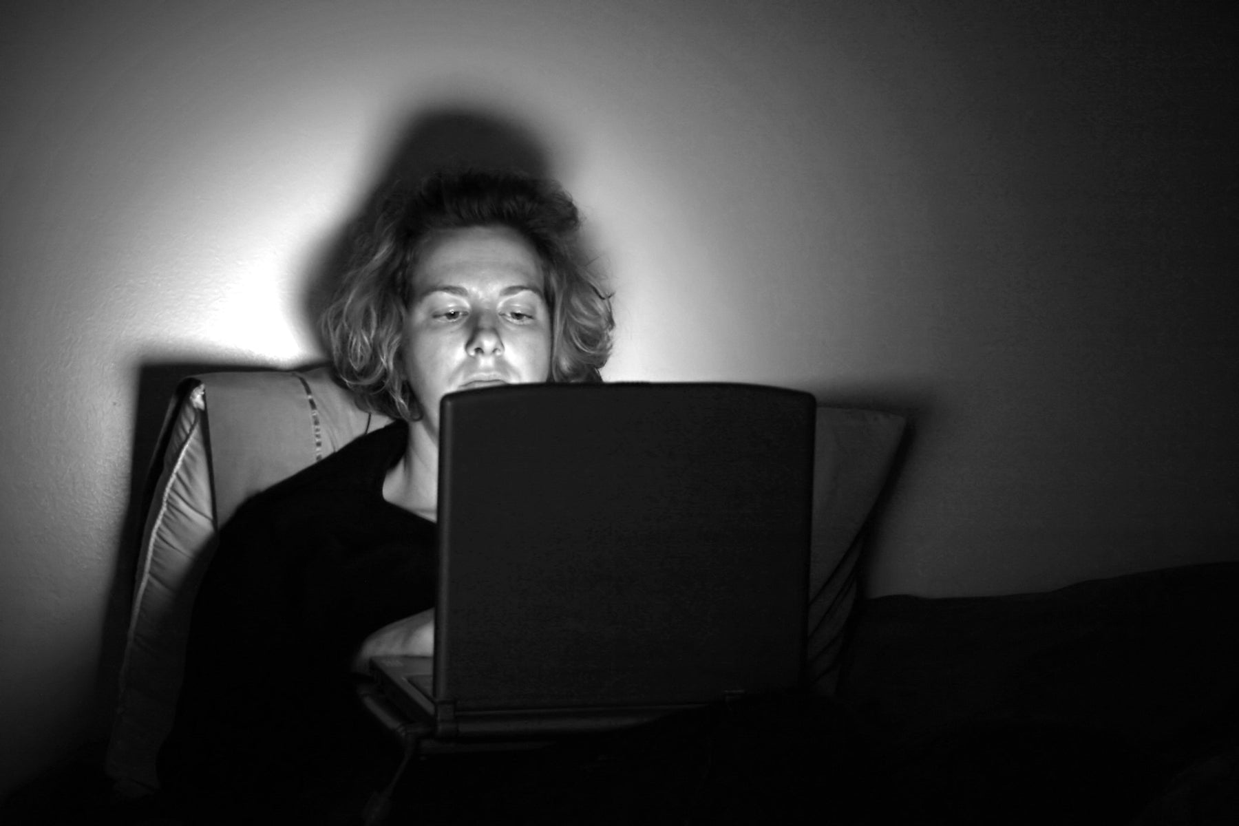Person On Computer Late Night In Bed Awake