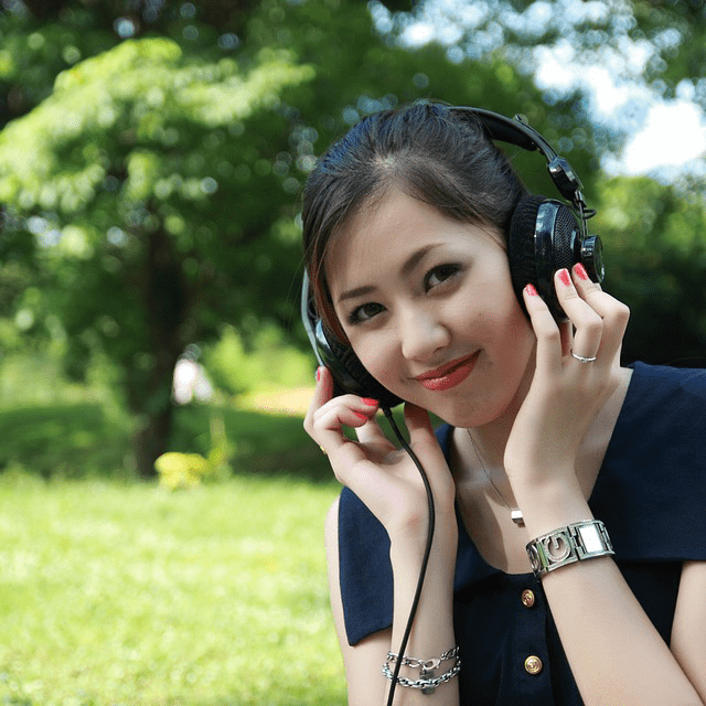 Girl Listening Headphones Park Smiling