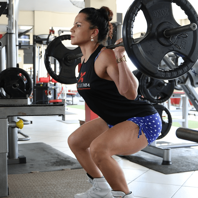 Woman In Gym Doing Weighted Squats