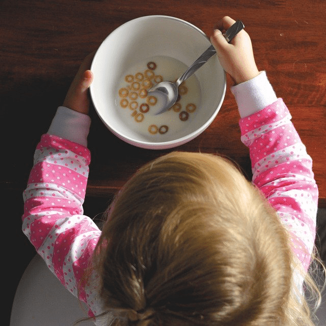 Child Girl Eating Breakfast Cereal