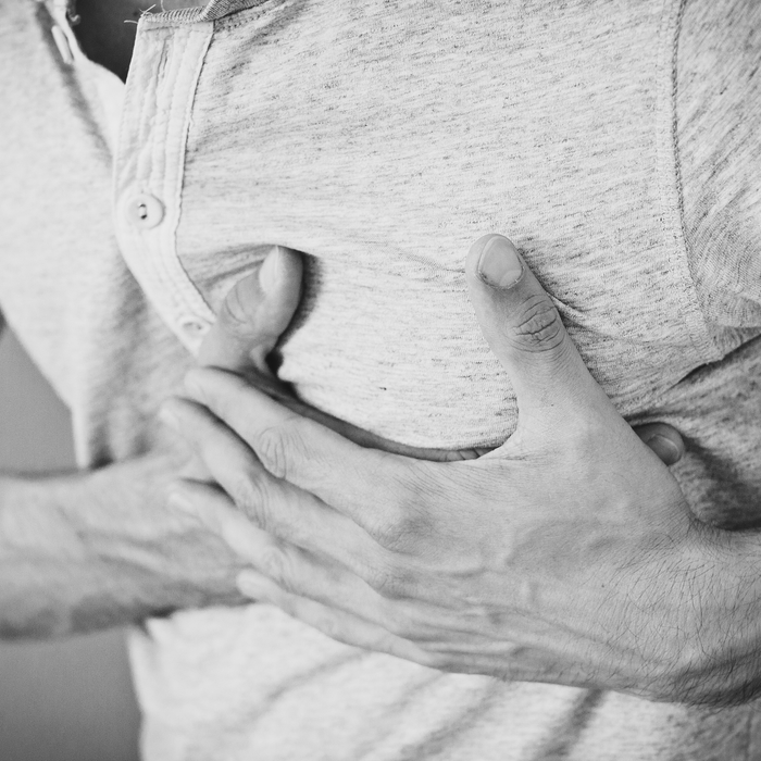Man Clutching Chest Heart Attack