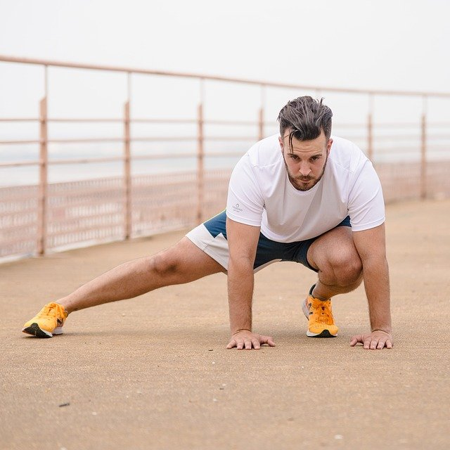 Man Stretching Warm Up Runner