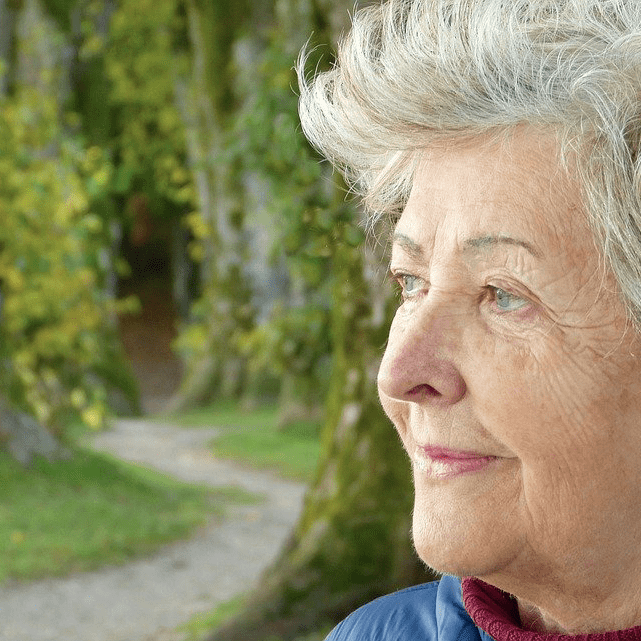 Woman Outside In Garden Elderly