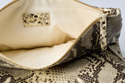 Image of Leather clutch in beige snake print