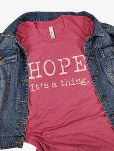 """Hope. It's a thing."" Short Sleeve Tee Shirt, Crew Neck, Heather Raspberry"