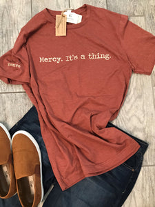 """Mercy. It's a thing."" Short Sleeve Tee Shirt, Crew Neck, Heather Clay"
