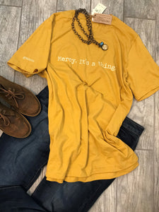 """Mercy. It's a thing."" Short Sleeve Tee Shirt, Crew Neck, Heather Mustard"