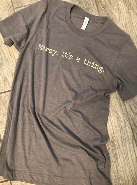"""Mercy. It's a thing."" Short Sleeve Tee Shirt, Crew Neck, Heather Storm"
