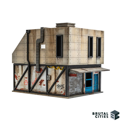 28mm terrain showing a Brutalist renovation on top of a delapidated brick shop
