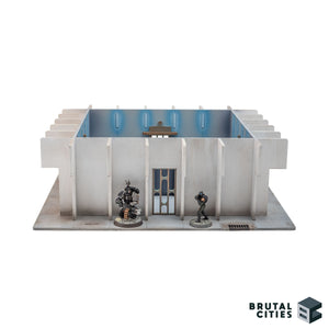 Miniatures standing next to the objective room doorway for scale