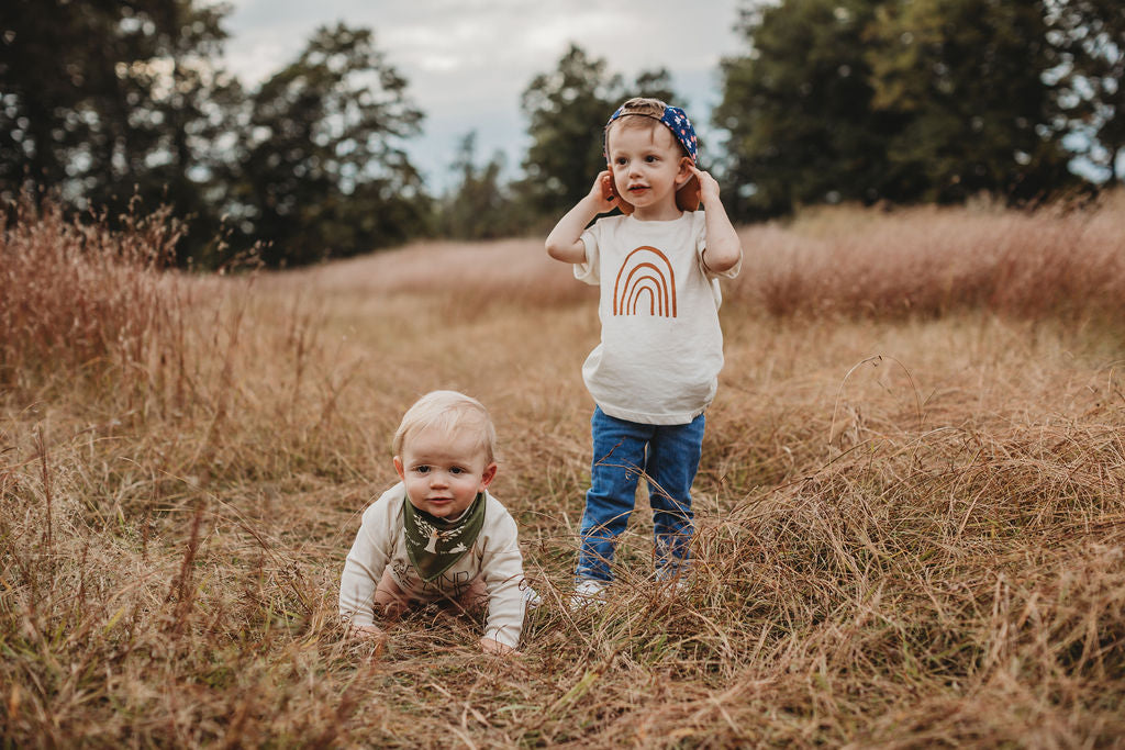 brothers in a field wearing organic cotton clothes